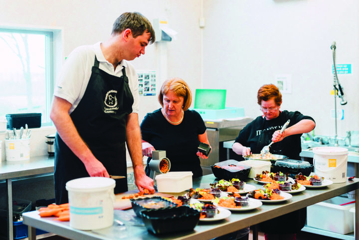 Michael helps in the kitchen at Larchfield Community